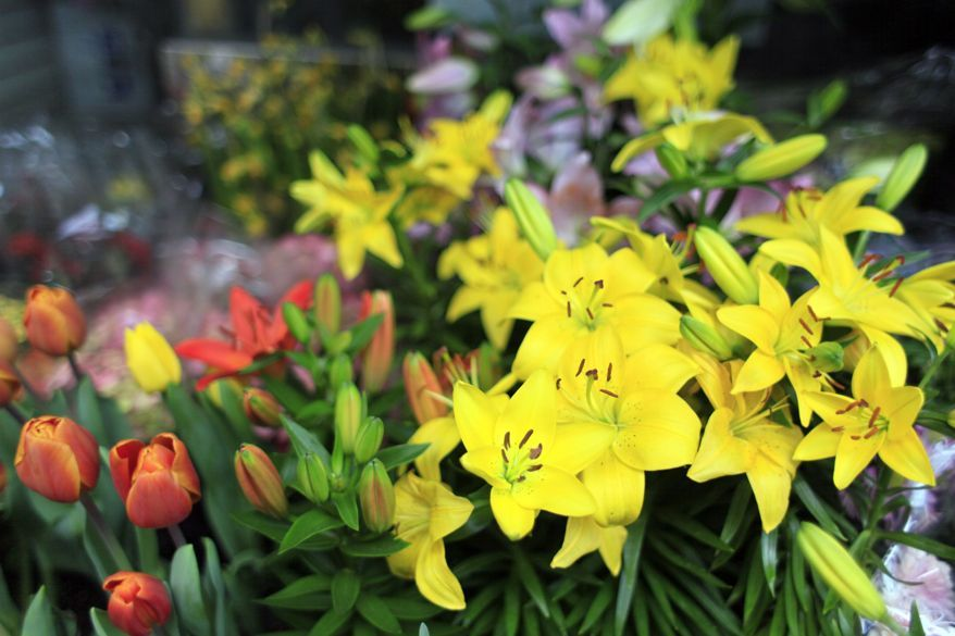 Flowers are displayed for sale in the Chinatown neighborhood of Manhattan in New York. (Associated Press/Mary Altaffer/File)