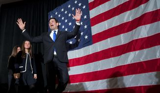 Republican presidential candidate Sen. Marco Rubio, R-Fla., gestures to the crowd as he arrives, followed by his daughters Amanda Rubio, 15, and Daniella Rubio, 13, at his primary night rally at the Radisson Hotel in Manchester, N.H., on Tuesday Feb. 9, 2016. (AP Photo/Jacquelyn Martin)