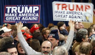 Supporters wait for Republican presidential candidate, businessman Donald Trump to speak during a primary night rally, Tuesday, Feb. 9, 2016, in Manchester, N.H. (AP Photo/Bill Sikes)