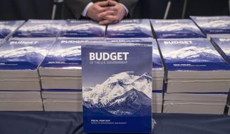 Copies of President Barack Obama's fiscal 2017 federal budget are displayed by the Senate Budget Committee, Tuesday, Feb. 9, 2016, on Capitol Hill in Washington. Leaders in the Republican-controlled Congress are already dismissing the president's spending blueprint and the chairs of the House and Senate budget committees will not be holding the traditional hearings with administration officials to testify on behalf of Obama's proposals.  (AP Photo/J. Scott Applewhite)