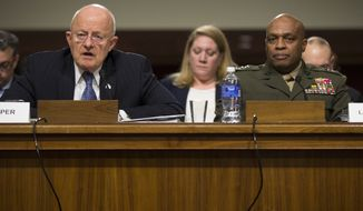 Director of National Intelligence James Clapper, left, testifies as Defense Intelligence Agency Director Lt. Gen. Vincent Stewart looks on during a Senate Armed Services Committee hearing about worldwide threats, on Capitol Hill, on Tuesday, Feb. 9, 2016, in Washington. (AP Photo/Evan Vucci)