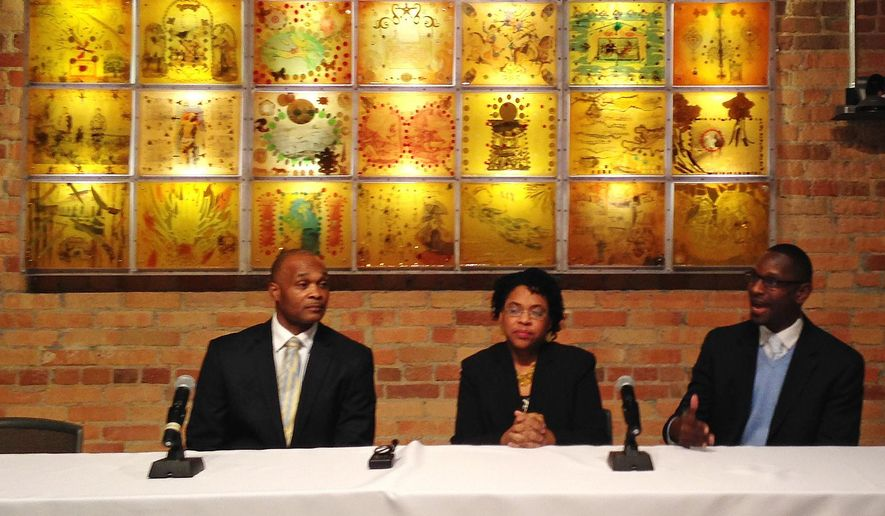 Jennifer Pinckney, the widow of a pastor slain in June along with eight others at a Charleston church, center, fields questions from reporters with family friends, the Rev. Kylon Middleton ,right, and the Rev. Chris Vaughn, left, on Tuesday, Feb. 9, 2016, at Duke University in Durham, N.C. Pinckney discussed the death of her husband, The Rev. Clementa Pinckney, with reporters before a speaking engagement at Duke University. (AP Photo/Jonathan Drew)