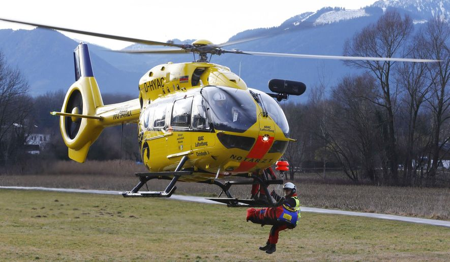 A rescue worker gives thumb up as a German rescue helicopter takes off in Bad Aibling, Germany,  Tuesday, Feb. 9, 2016. At least four people were killed in a train crash nearby. (AP Photo/Matthias Schrader)
