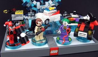 Lego Dimensions' owners can now build minifigures of Harley Quinn, Peter Venkman and the Joker along with a ghost trap, the Ecto 1, the Joker's chopper and the Quinn-Mobile with purchase of the Ghostbusters Level Pack and DC Comics Fun Pack. (Photograph by Joseph Szadkowski / The Washington Times)