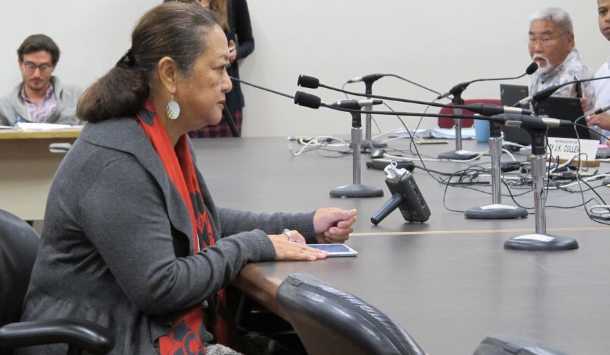 Lorna Cummings Poe, a Kauai resident, speaks to Hawaii lawmakers that she believes her granddaughters were sickened after exposure to pesticides at a legislative hearing on Tuesday, Feb. 9, 2016 in Honolulu. Parents are pushing Hawaii lawmakers to establish pesticide buffer zones around schools. (AP Photo/Cathy Bussewitz)