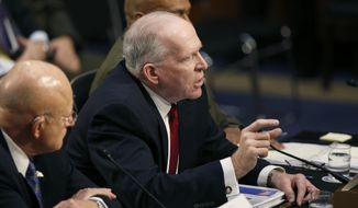 CIA Director John Brennan, flanked by Director of the National Intelligence Director James Clapper, left, and Defense Intelligence Agency Director Lt. Gen. Vincent Stewart, testifies on Capitol Hill in Washington, Tuesday, Feb. 9, 2016, before Senate Intelligence Committee hearing on worldwide threats. (AP Photo/Alex Brandon)