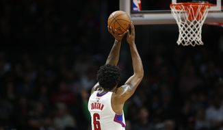 Los Angeles Clippers' DeAndre Jordan shoots a free throw against the Portland Trail Blazers during the second half of an NBA basketball game, Monday, Nov. 30, 2015, in Los Angeles. The Clippers won 102-87. (AP Photo/Danny Moloshok)