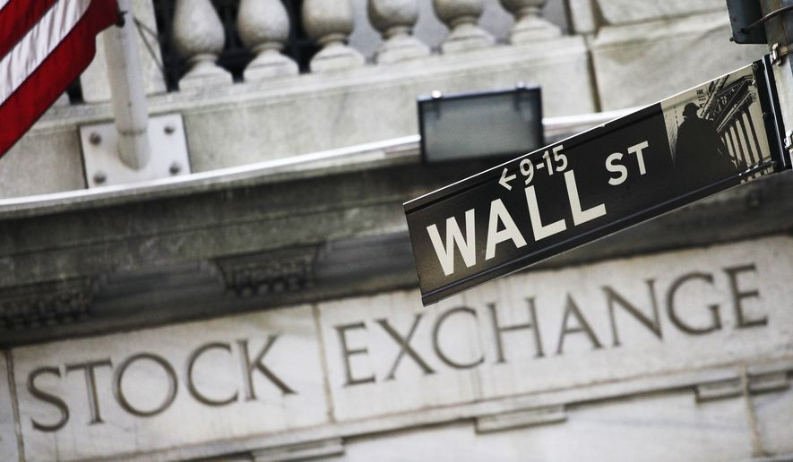 This July 16, 2013, file photo, shows a Wall Street street sign outside the New York Stock Exchange. (AP Photo/Mark Lennihan, File)