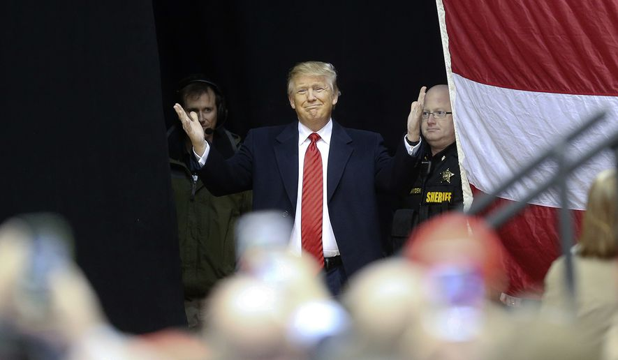 Republican presidential candidate Donald Trump reacts as he steps on stage for a rally at Clemson University Wednesday, Feb. 10, 2016, in Pendleton, S.C. (AP Photo/John Bazemore)