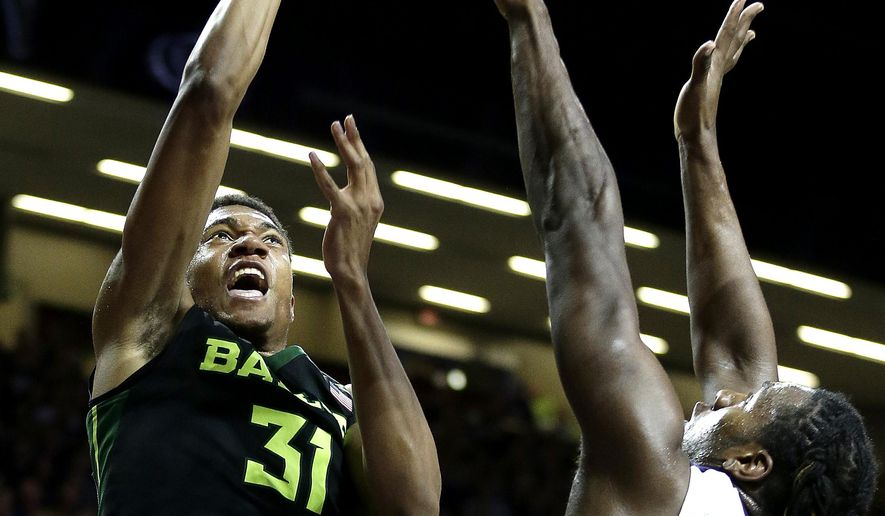 Baylor's Terry Maston (31) shoots over Kansas State's D.J. Johnson (4) during the first half of an NCAA college basketball game Wednesday, Feb. 10, 2016, in Manhattan, Kan. (AP Photo/Charlie Riedel)