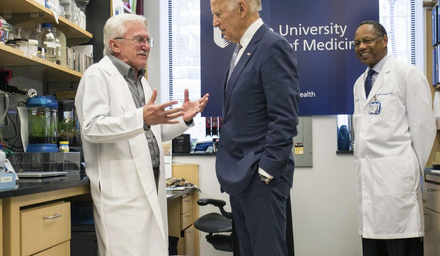 Vice President Joe Biden speaks with Nobel Laureate Dr. Paul Modrich, left, as Dr. A. Eugene Washington, Chancellor for Health Affairs at Duke University, right listens in a laboratory at Duke University School of Medicine in Durham, N.C. Wednesday, Feb. 10, 2016. VBiden visited Duke to speak about his Cancer Moonshot initiative. (AP Photo/Ben McKeown)