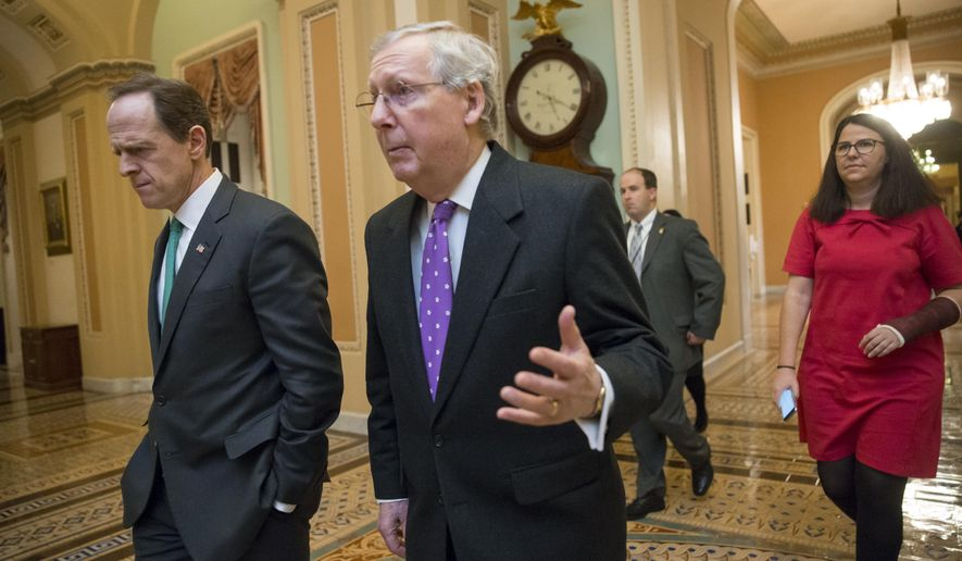 Senate Majority Leader Mitch McConnell, R-Ky., center, walks with Sen. Pat Toomey, R-Pa., left, to the chamber for the vote to impose more stringent sanctions on North Korea for willfully violating international law by pushing ahead with its nuclear weapons program and for what they say are flagrant violations of international law, at the Capitol in Washington, Wednesday, Feb. 10, 2016.  (AP Photo/J. Scott Applewhite)