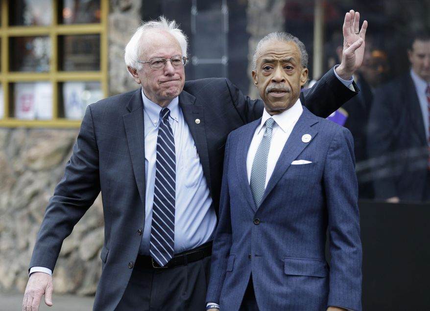 Democratic presidential candidate Sen. Bernie Sanders, I-Vt., left, waves to media and supporters after a breakfast meeting with Al Sharpton at Sylvia's Restaurant, Wednesday, Feb. 10, 2016, in the Harlem neighborhood of New York. Sanders defeated former Secretary of State Hillary Clinton on Tuesday in the New Hampshire primary. (AP Photo/Seth Wenig)