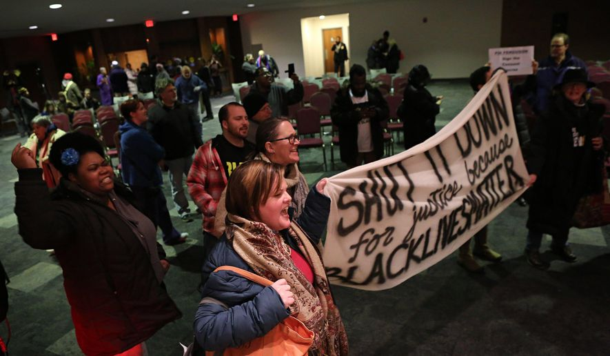 Protesters chant and yell after the Ferguson, Mo., city council meeting in Ferguson on Tuesday, Feb. 9, 2016, where the council voted to approve a modified consent decree with the United States Department of Justice. It is unclear if the Department of Justice will agree to the modifications. (David Carson/St. Louis Post-Dispatch via AP)