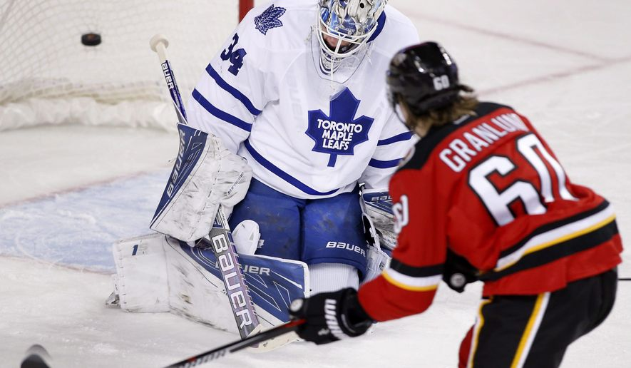 Calgary Flames' Markus Granlund (60) from Finland scores a short handed goal on Toronto Maple Leafs goalie James Reimer during first period NHL action in Calgary, Alberta, Tuesday, Feb. 9, 2016. (Larry MacDougal/The Canadian Press via AP) MANDATORY CREDIT