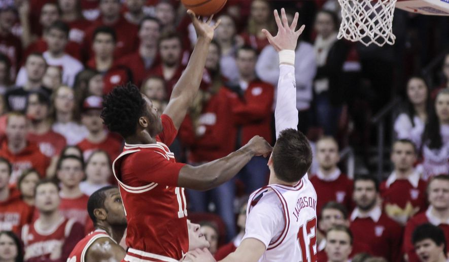 Wisconsin's Nigel Hayes (10) shoots against Nebraska's Michael Jacobson (12) during the first half of an NCAA college basketball game Wednesday, Feb. 10, 2016, in Madison, Wis. (AP Photo/Andy Manis)