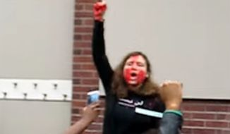 Students at Rutgers University smeared themselves with fake blood to protest a speech given by Milo Yiannopoulos, a gay British conservative who writes for Breitbart News. (YouTube/@Wiser InTime)