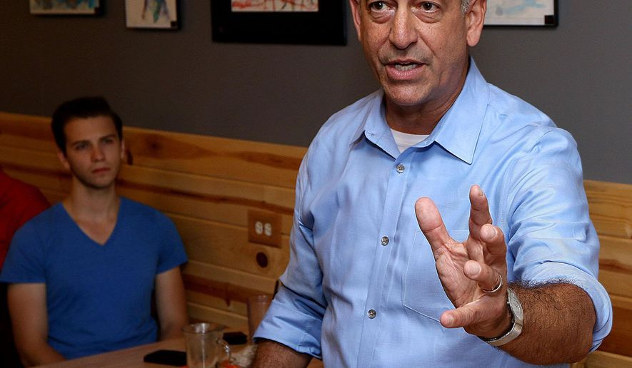 FILE - In this July 21, 2015 file photo, Wisconsin US Senate hopeful Russ Feingold speaks during a campaign stop, in Eau Claire, Wis. Feingold is avoiding endorsing either Hillary Clinton or Bernie Sanders in the hotly contested Democratic race for president. Feingold is trying to knock off incumbent Republican Sen. Ron Johnson in one of the most closely watched Senate races in the country. (Steve Kinderman/The Eau Claire Leader-Telegram via AP)
