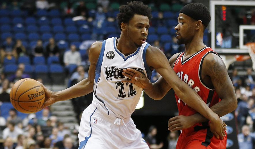 Minnesota Timberwolves forward Andrew Wiggins (22) pushes the ball around Toronto Raptors guard Terrence Ross (31) in the first half of an NBA basketball game Wednesday, Feb. 10, 2016, in Minneapolis. (AP Photo/Stacy Bengs)