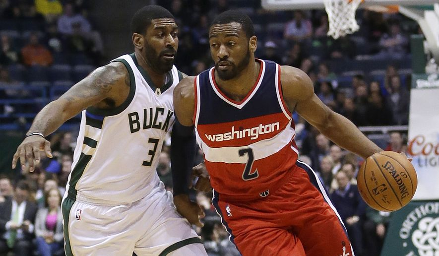 Washington Wizards' John Wall (2) drives against Milwaukee Bucks' O.J. Mayo (3) during an NBA basketball game Thursday, Feb. 11, 2016, in Milwaukee. (AP Photo/Aaron Gash)