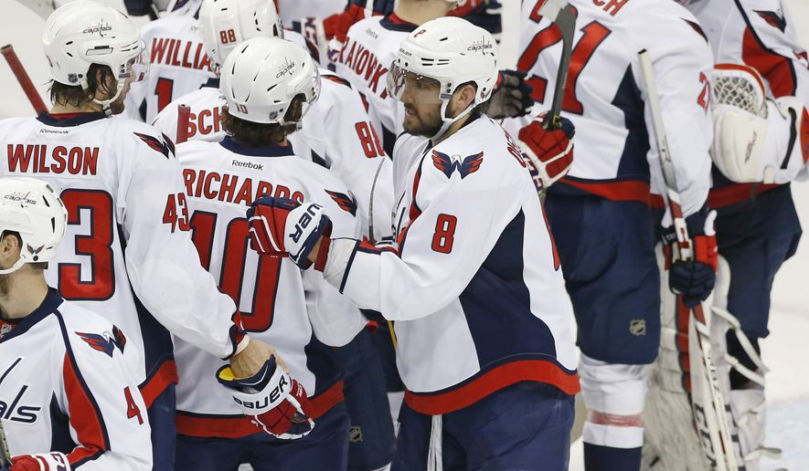 Washington Capitals' Alex Ovechkin (8) of Russia goes through the celebration line after the Capitals beat the Minnesota Wild 4-3 in an NHL hockey game, Thursday, Feb. 11, 2016, in St. Paul, Minn. The Capitals won 4-3. Ovechkin had a hat trick with his three second period goals.  (AP Photo/Jim Mone)