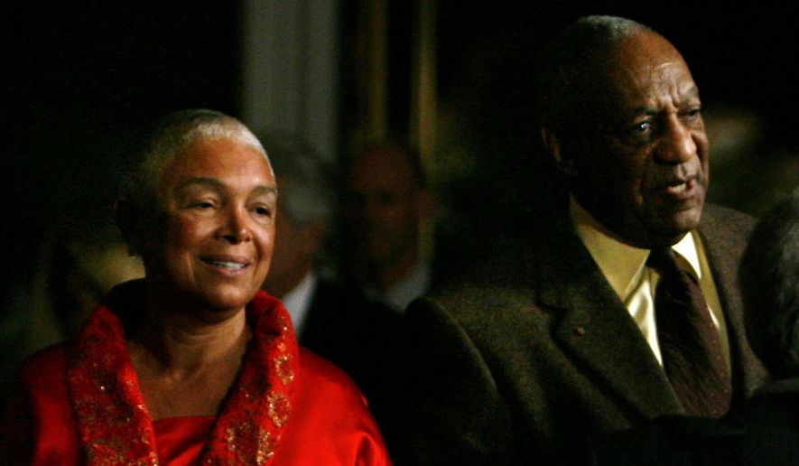 File- This Oct.26, 2009, file photo shows comedian Bill Cosby entering the Kennedy Center with his wife Camille in Washington. A federal judge in Massachusetts has ruled that Cosby's wife must answer questions under oath in a defamation lawsuit filed by seven women who claim Cosby sexually assaulted them decades ago. A lawyer for the women has sought to compel Camille Cosby to give a deposition in the lawsuit. Last month, a magistrate judge rejected Cosby's bid to quash the deposition subpoena.  (AP Photo/Jacquelyn Martin, File)