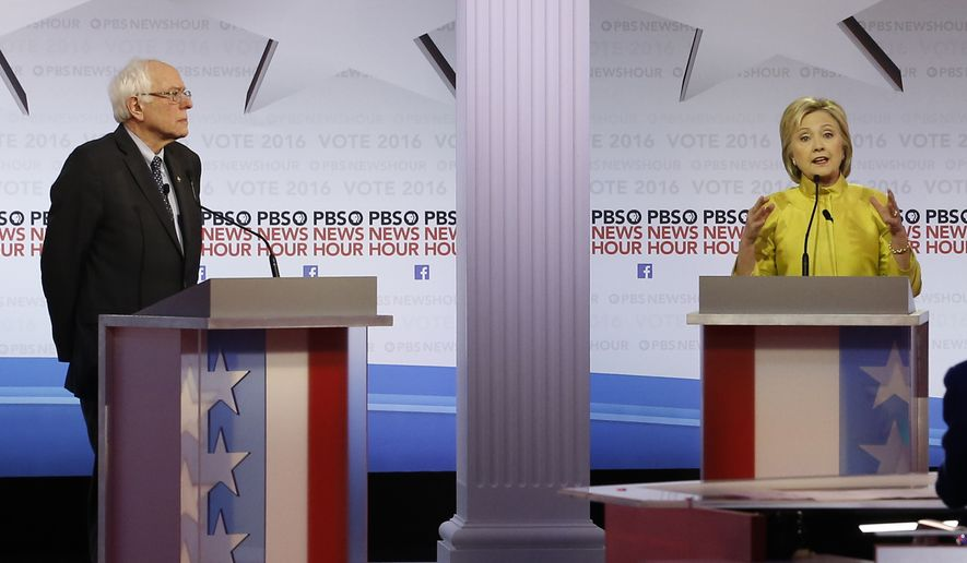 Democratic presidential candidate Hillary Clinton makes a point as Sen. Bernard Sanders listens during a Democratic presidential primary debate at the University of Wisconsin-Milwaukee on Thursday. (Associated Press)