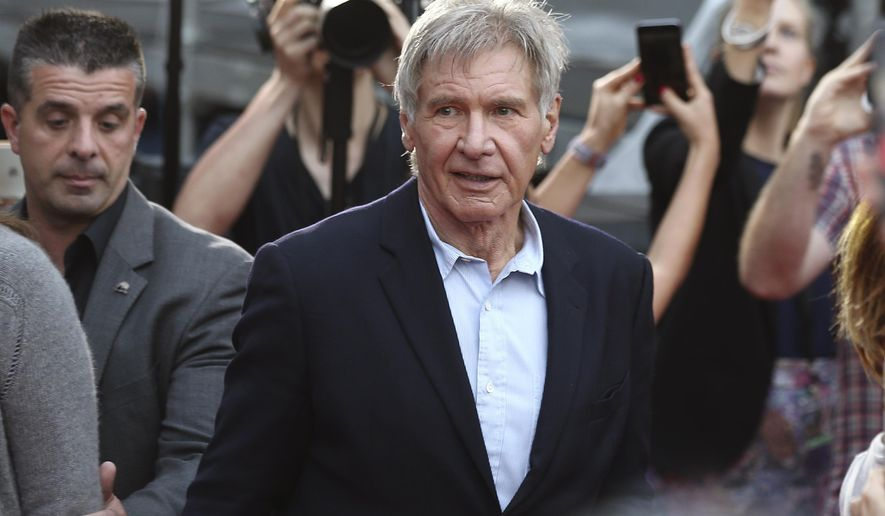 "FILE - In this December 10, 2015 file photo Harrison Ford walks during a Star Wars fan event in Sydney. Ford is in Australia to promote his latest film ""Star Wars: The Force Awakens"". British health authorities said on Thursday Feb. 11, 2016 that criminal charges have been laid against producers of ""Star Wars: The Force Awakens"" over an on-set accident in which Harrison Ford broke his leg. (AP Photo/Rob Griffith, File)"