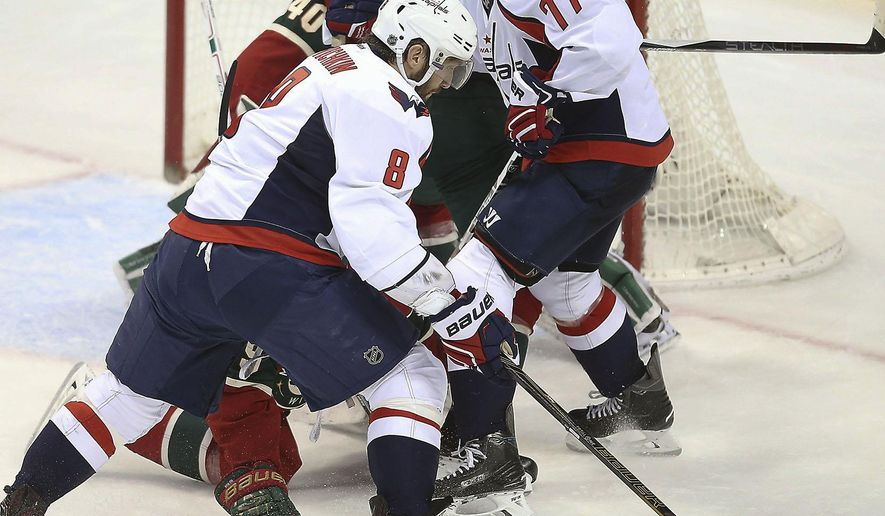 Washington Capitals left wing Alex Ovechkin works the puck against the Minnesota Wild during the second period of an NHL hockey game, Wednesday, Feb. 11, 2016 in St. Paul, Minn. (Elizabeth Flores/Star Tribune via AP)  MANDATORY CREDIT; ST. PAUL PIONEER PRESS OUT; MAGS OUT; TWIN CITIES LOCAL TELEVISION OUT