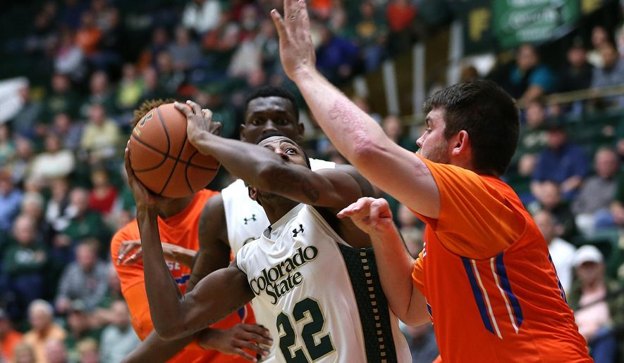 Rams guard J.D. Paige drives to the hoop during Colorado State's 97-93 double overtime win over the Boise State Broncos on Wednesday, Feb. 10, 2016, at Moby Arena in Fort Collins, Colo. The Rams had won three of their last five games coming into the contest and will start a two game road trip at the University of Nevada, Las Vegas on Feb. 13.  (Brian Smith/The Coloradoan via AP)