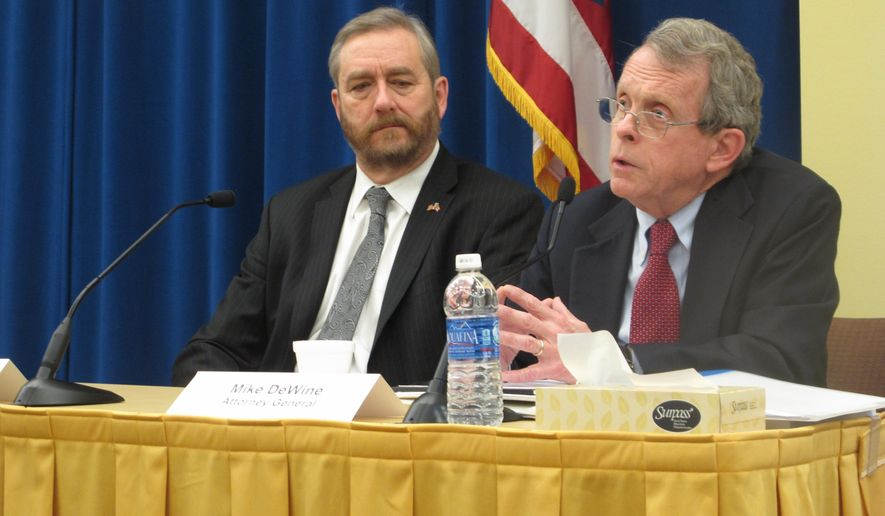 CORRECTS ID OF INDIVIDUALS IN PHOTO AS WELL AS DETAILS THROUGHOUT CAPTION -Ohio Attorney General Mike DeWine, right, responds to a question on medical marijuana legislation in a Q&A session with state Auditor David Yost, at a forum for journalists organized by The Associated Press, on Thursday, Feb. 11, 2016, in Columbus, Ohio. DeWine said it's up to the legislature, while noting ongoing clinical trials examining the use of medical marijuana. Yost said he supports tightly controlled medical marijuana. (AP Photo/Andrew Welsh-Huggins)