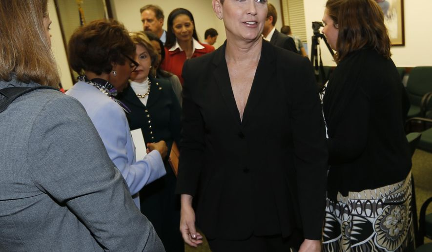Beth Ferrier, one of two Denver women who claim to have been sexually assaulted by comic Bill Cosby, heads to a hearing room after a news conference Thursday, Feb. 11, 2016, in the State Capitol in Denver. Attorney Gloria Allred and the two Denver women were on hand to testify before a House committee on whether to permit rape victims to seek criminal charges against offenders beyond the state's 10-year statute of limitations. (AP Photo/David Zalubowski)