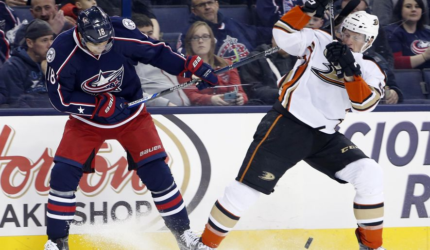 Columbus Blue Jackets' Rene Bourque, left, and Anaheim Ducks' Josh Manson fight for a loose puck during the second period of an NHL hockey game Thursday, Feb. 11, 2016, in Columbus, Ohio. (AP Photo/Jay LaPrete)