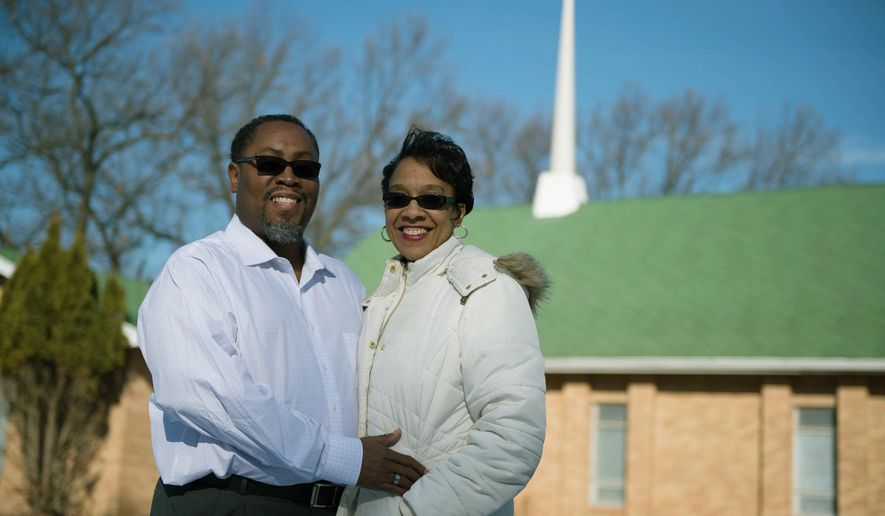 "In a photo from Feb. 6, 2016, Pastor John Boyd and his wife, Stephanie, stand outside the Berean Seventh-day Adventist Church in Battle Creek, Mich. The couple has opened a new Baptist-affiliated church in Battle Creek called Love in Action Community Ministries, which will hold services Sundays and Tuesdays in the Berean Seventh-day Adventist Church. Their first Sunday service took place Sunday, and Tuesday marked their first weekday prayer service and Bible study. For now, Love in Action will be ""church sharing"" with the Seventh-day Adventists. (Al Lassen/Battle Creek Enquirer via AP)"