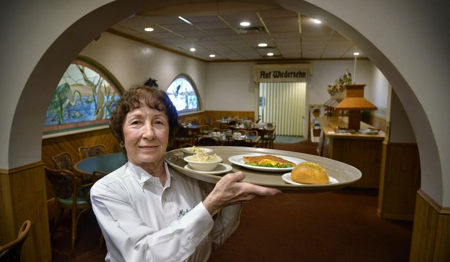 FOR RELEASE SATURDAY, FEBRUARY 13, 2016, AT 12:01 A.M. CST.- At 81, Michael's restaurant server Clara Riley has been waitressing for 50 years and doesn't have any plans to stop now. She was photographed Feb. 4, 2016 in St. Cloud, Minn. Michael's restaurant specializes in Austrian cuisine. (Kimm Anderson/The St. Cloud Times via AP)