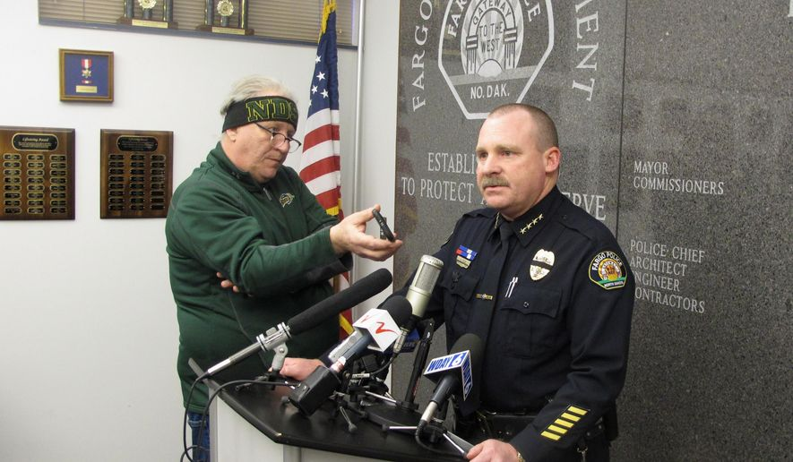 Fargo Police Chief Dave Todd appears at a news conference at police headquarters in Fargo, N .D., on Thursday, Feb. 11, 2016to talk about a shooting that left one of his officers mortally wounded and a suspect dead. Todd says Officer Jason Moszer, a six-year veteran of the force, is not expected to recover from his wounds. It would be just the second police fatality in the line of duty in Fargo. (AP Photo/Dave Kolpack)