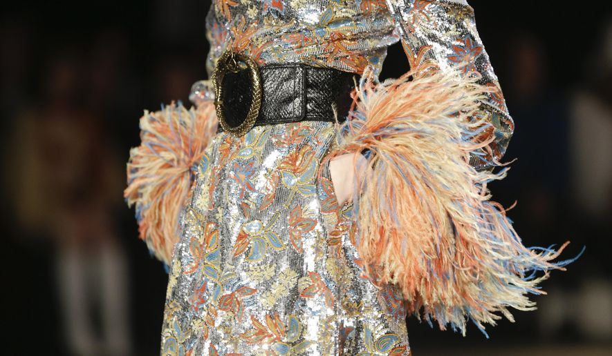 A model walks the runway wearing a creation by Saint Laurent Paris at the Palladium in the Hollywood area of Los Angeles, Wednesday, Feb. 10, 2016. (AP Photo/Chris Carlson)