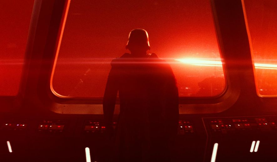 """This photo provided by Disney/Lucasfilm shows a scene from the new film, """"Star Wars: The Force Awakens."""" The film is still playing in more than 2,000 theaters in North America and remains ranked in the top-five at the box office as it enters its ninth week of release. (Film Frame/Disney/Lucasfilm via AP)"""