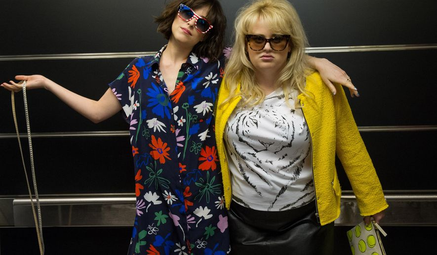 """This image released by  Warner Bros. Entertainment Inc. shows Dakota Johnson, left, and Rebel Wilson in a scene from, """"How to Be Single."""" (Barry Wetcher/Warner Bros. Entertainment via AP)"""