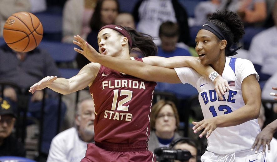 Duke's Crystal Primm (13) and Florida State's Brittany Brown (12) reach for the ball during the first half of an NCAA college basketball game in Durham, N.C., Thursday, Feb. 11, 2016. (AP Photo/Gerry Broome)