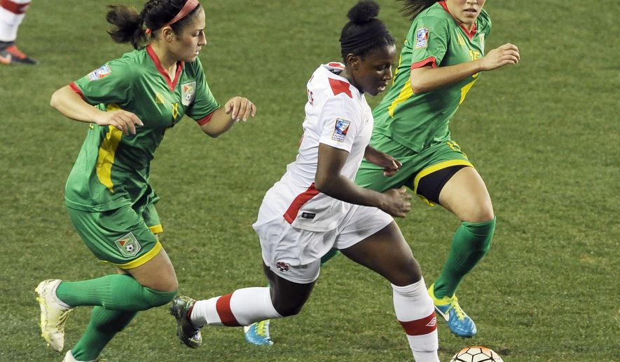 Canada's Deanne Rose, center, drives the ball between Guyana's Kayla De Souza, left, and Mariam El-Masri during the first half of a CONCACAF Olympic qualifying tournament soccer match Thursday, Feb. 11, 2016, in Houston. (AP Photo/Pat Sullivan)