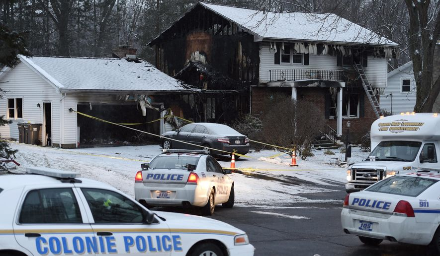 Law enforcement officials investigate a fatal fire, Wednesday, Feb. 10, 2016, in Colonie, N.Y. Police in upstate New York say bodies have been found in a house owned by a local police officer after firefighters responded to a fire at the home. (Skip Dickstein/The Albany Times Union via AP)  TROY, SCHENECTADY; SARATOGA SPRINGS; ALBANY OUT; MANDATORY CREDIT