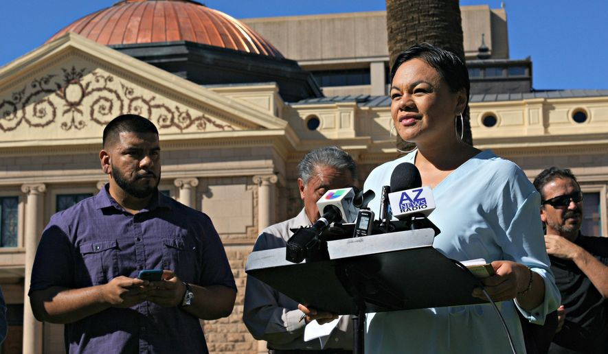 Francisca Porchas, right, organizing director for Puente, speaks out against a series of bills targeting immigrants on Thursday, Feb. 11, 2016, in Phoenix, Ariz. Porchas is part of a human rights and immigrant justice organization. (AP Photo/Ryan Van Velzer)