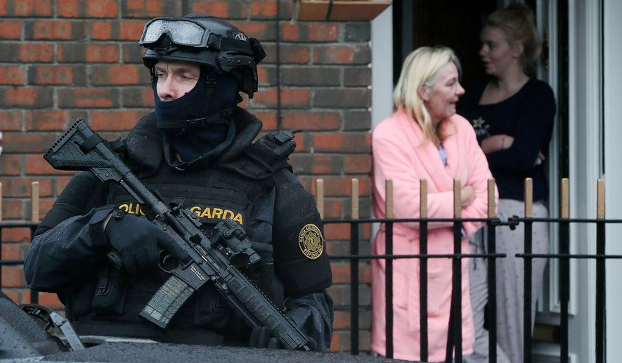 Armed Gardai from the force's Emergency Response Unit on patrol, as gang violence has resulted in two murders in four days, in Dublin, Ireland, Tuesday, Feb. 9, 2016. As Dublin's gangland tensions deepened, Ireland's justice minister urged gang members to seek police protection Tuesday after gunmen shot to death the brother of a Dublin crime kingpin in apparent retaliation for last week's deadly attack on a boxing ceremony. Police have put in roadblocks, increased surveillance on high-profile targets and placed an imprisoned relative of a crime boss into protective custody. (Niall Carson/PA via AP)     UNITED KINGDOM OUT        -    NO SALES     -      NO ARCHIVES