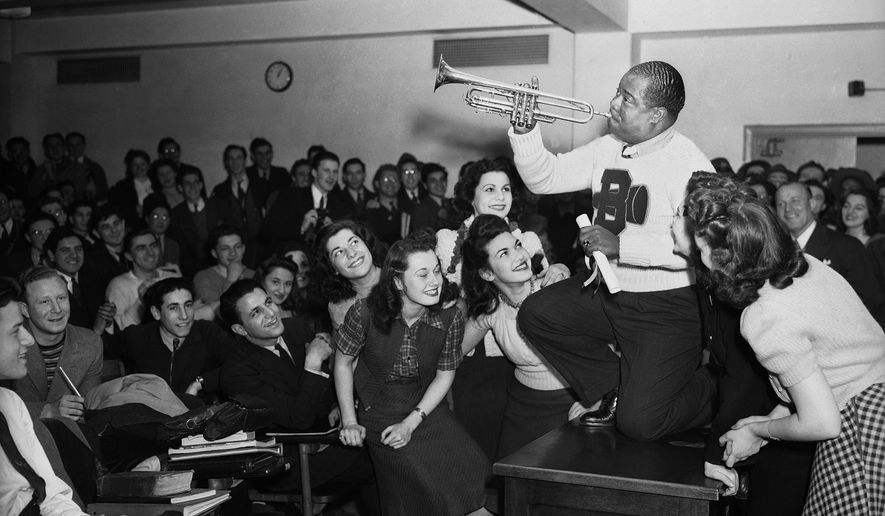 """FILE - In this March 12, 1941, file photo, Louis Armstrong, wearing a Brooklyn College sweater, performs on the campus in New York as the school honored him with the degree """"Doctor of Swing."""" Armstrong, Placido Domingo, Yo-Yo Ma, Audra McDonald, Leontyne Price and Harold Prince are this year's selections for the Performing Arts Hall of Fame at Lincoln Center. Jed Bernstein, president of Lincoln Center for the Performing Arts, made the announcement Thursday, Feb. 11, 2016. The honorees will be inducted June 20 during a ceremony at Lincoln Center's Alice Tully Hall.   (AP Photo/File)"""