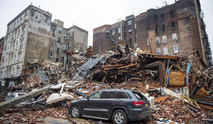 FILE - In this March 27, 2015 file photo, a pile of debris remains at the site of a building explosion in the East Village neighborhood of New York. The Manhattan district attorney and others make an announcement on Thursday, Feb. 11, 2016,  about the investigation into the March 2015 explosion that killed two people and leveled three buildings in the East Village. (Nancy Borowick/The New York Times via AP, Pool)