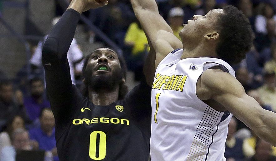 Oregon's Dwayne Benjamin (0) shoots against California's Ivan Rabb, right, in the first half of an NCAA college basketball game Thursday, Feb. 11, 2016, in Berkeley, Calif. (AP Photo/Ben Margot)