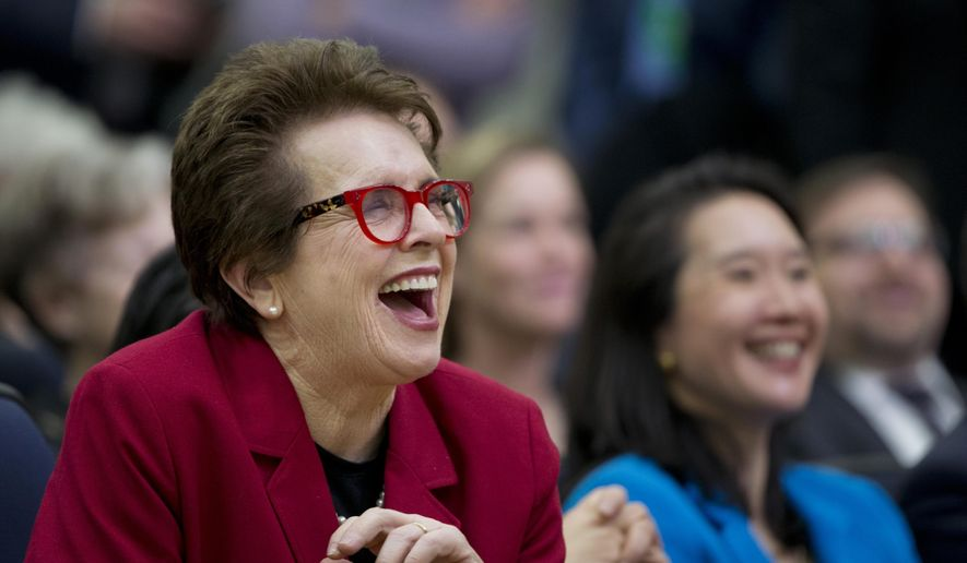 Tennis legend Billie Jean King, left, laughs, reacting to President Barack Obama's remarks at a gathering in the Eisenhower Executive Office Building on the White House complex in Washington, in this Jan. 29, 2016, file photo. King was the keynote speaker Wednesday, Feb. 10, 2016 ,at an annual luncheon honoring the birthday of suffragist Susan B. Anthony, who was born on Feb. 15, 1820. (AP Photo/Manuel Balce Ceneta)