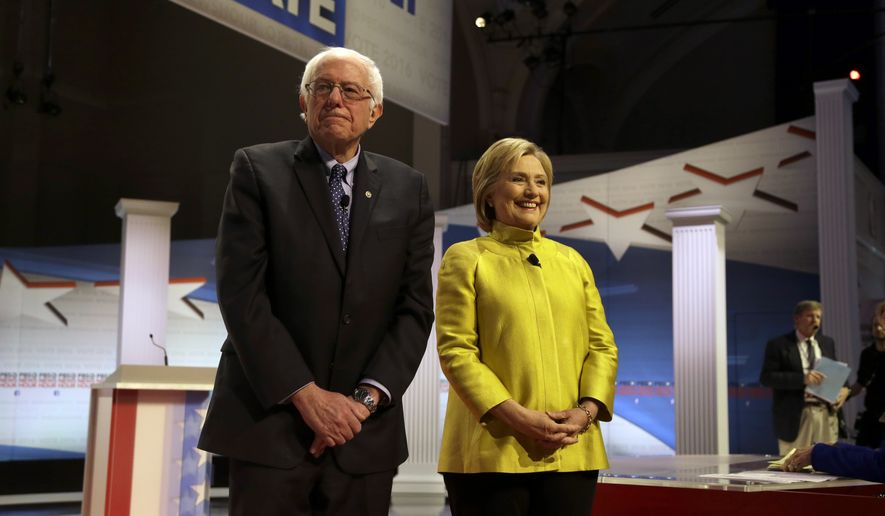 Democratic presidential candidates Sen. Bernie Sanders, I-Vt, left, and Hillary Clinton take the stage before a Democratic presidential primary debate at the University of Wisconsin-Milwaukee, Thursday, Feb. 11, 2016, in Milwaukee. (AP Photo/Tom Lynn)