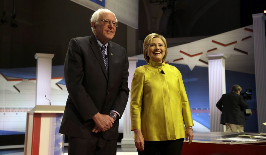 Democratic presidential candidates Sen. Bernie Sanders, I-Vt, left, and Hillary Clinton take the stage before a Democratic presidential primary debate at the University of Wisconsin-Milwaukee, Thursday, Feb. 11, 2016, in Milwaukee. (AP Photo/Tom Lynn) ** FILE **